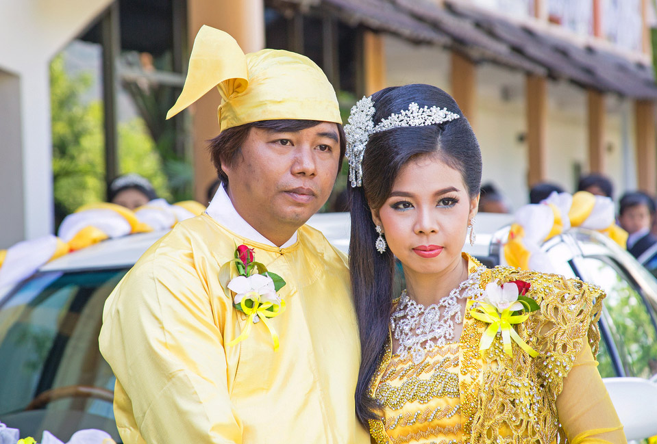 Newly-weds in traditional dress in Mandalay.