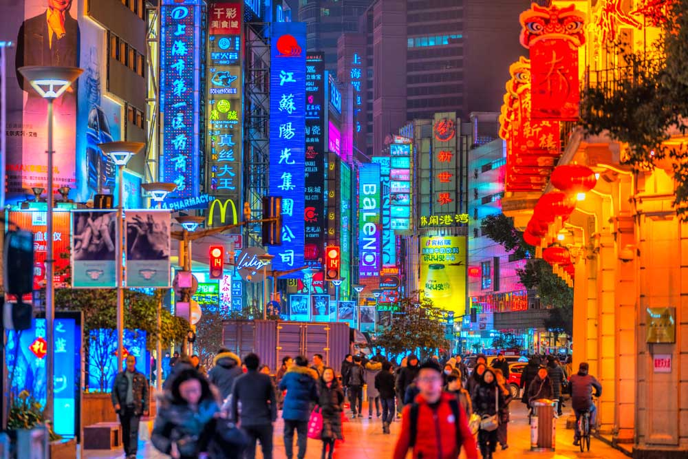 Neon signs lit on Nanjing Road.