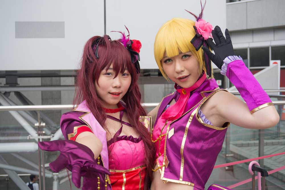 Cosplayers portray a character from Idol Master at the Comiket, the world's largest 'doujinshi' or fan made self-published works fair in Tokyo, Japan.