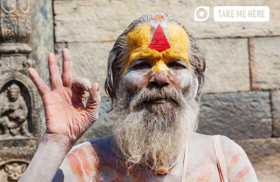 Nepalese sadhu man meditating on the street of Kathmandu.