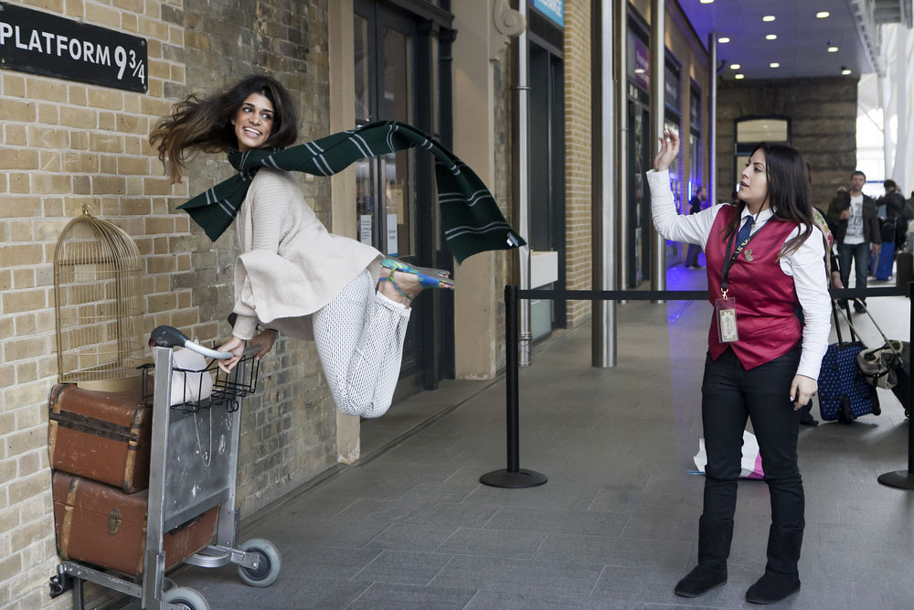 Kings Cross station wall visited by fans of Harry Potter to photograph sign for platform nine and three quarters with trolley. Photo: Shutterstock