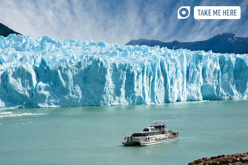 Boat sailing near Perito Moreno glacier in Patagonia.