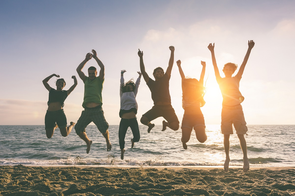Young People Jumping at Beach. Photo: William Perugini/Shutterstock