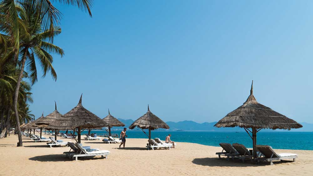 Sunbeds and umbrellas on the beach of Nha Trang
