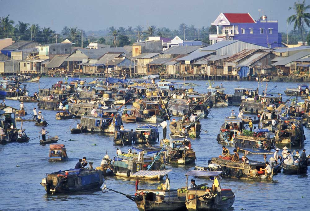 People at the Flooting Market on the Mekong River near the city of Can Tho in the Mekong Delta
