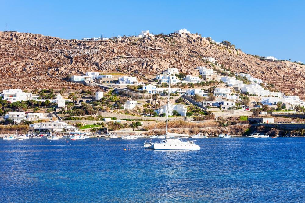 Yachts off Ornos Beach on Mykonos, Greece.