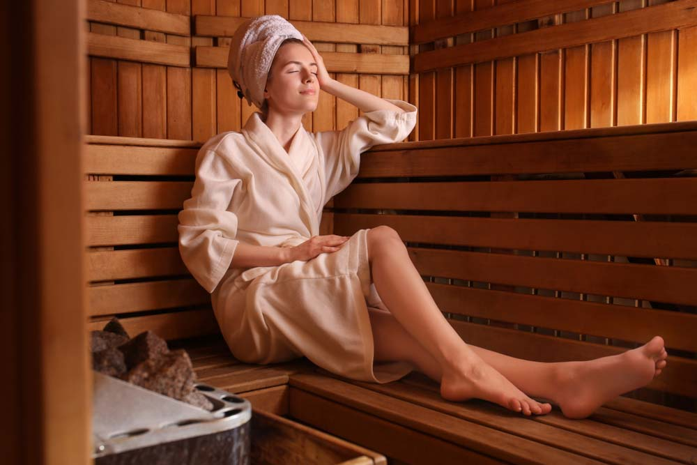 Woman enjoying a sauna.