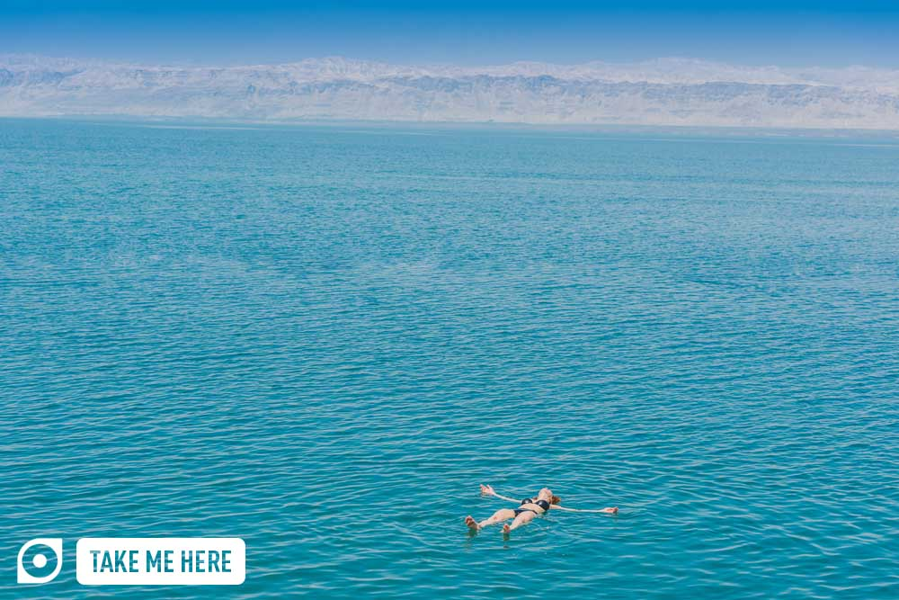Floating in the salt-heavy Dead Sea, Jordan.