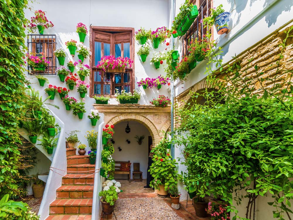 Traditional house patio decorated with flowers in Córdoba, Spain.