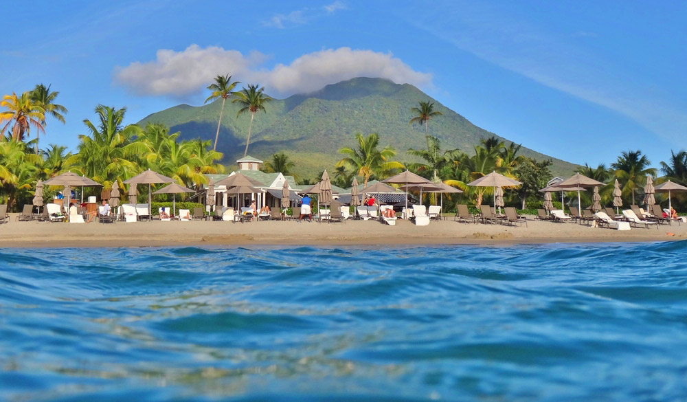 Located on Pinney's Beach at the foot of the Nevis Peak volcano, the Four Seasons Nevis is a luxury hotel overlooking the Caribbean Sea in the island of Nevis. Photo: Shutterstock