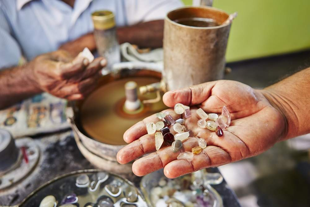 A craftsman shows off his moonstones. Photo: Jaromir Chalabala/Shutterstock
