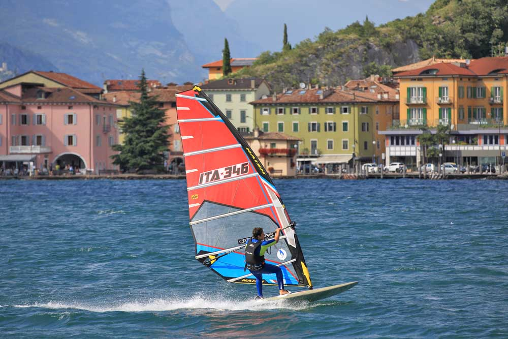 A windsurfer pro-rider surfing at high speed on Lake Garda. Photo: Shutterstock
