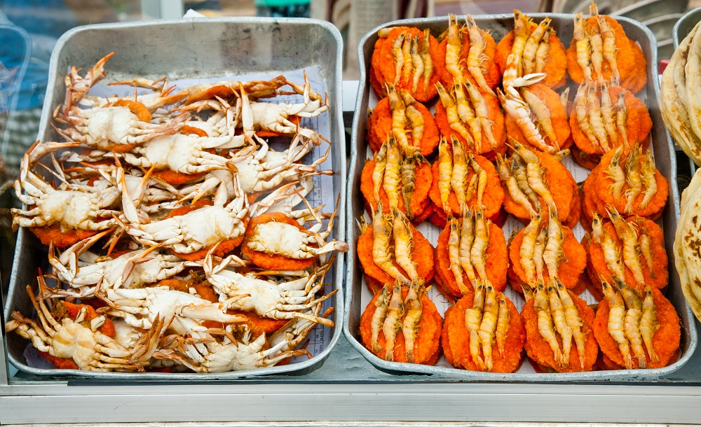 Spicy flat cakes with crabs and prawns on dishes in Colombo city, Sri Lanka. Photo: Dmitry Naumov/Shutterstock