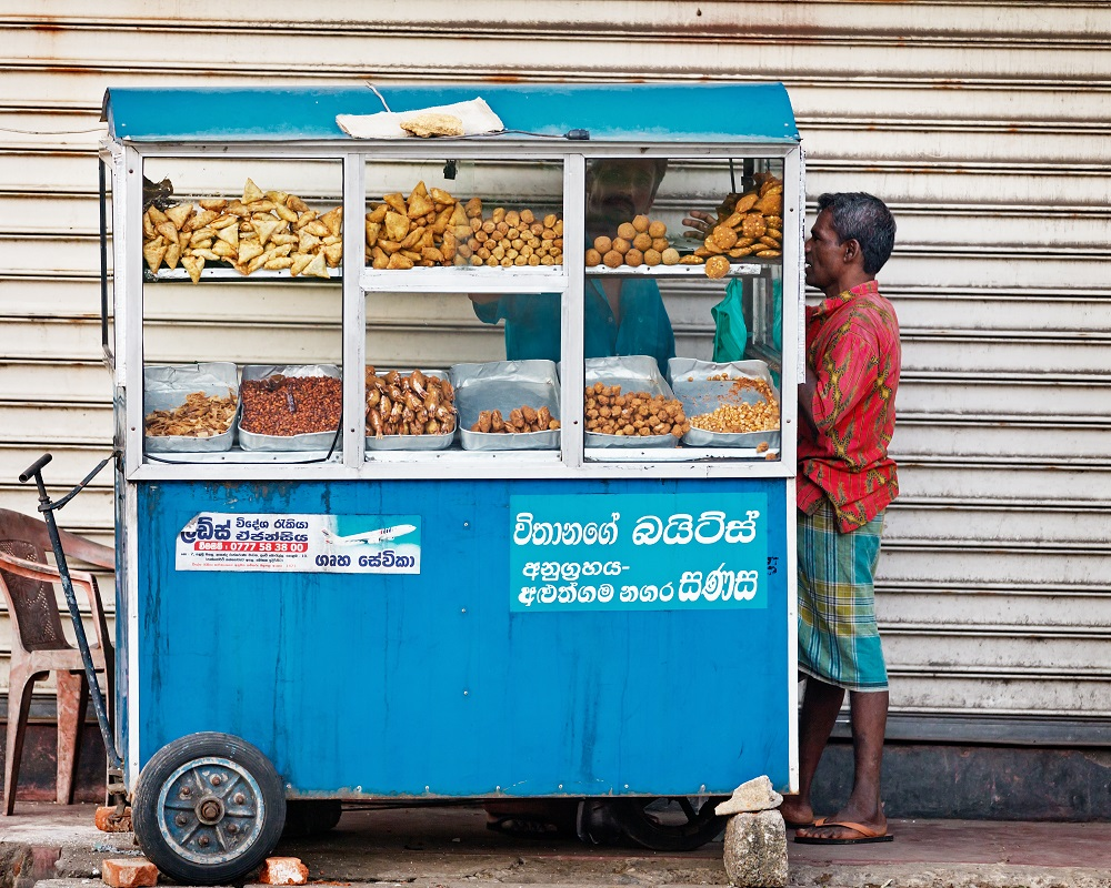 Mobile street food sellers are popular in Sri Lanka. Photo: pzAxe/Shutterstock
