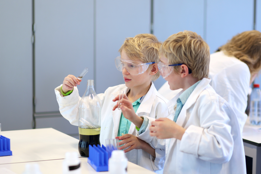 Making science experiments. Photo: CroMary/Shutterstock