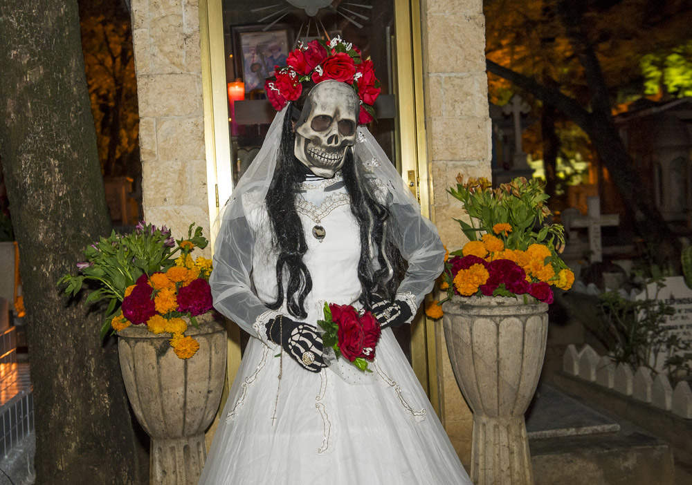 A person with a costume on a cemetery in the Day of the Dead in Oaxaca, Mexico. Photo: Shutterstock