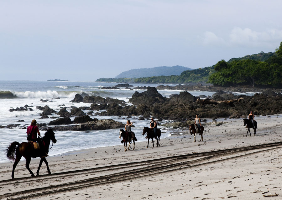 Visitors can ride on horseback to nearby waterfalls from Montezuma beach.
