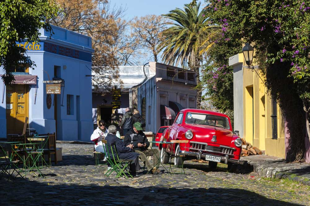 Vintage cars participate in the street exhibition in Historic neighbourhood in Colonia, Unesco World Heritage town - in Colonia del Sacramento, Uruguay.
