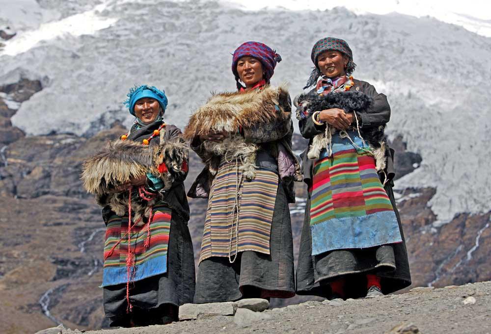 Three Tibetan women in traditional dresses in Nepal
