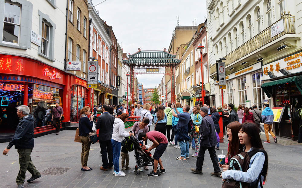 People walk along a busy shopping street in London's Chinatown. Photo: Shutterstock
