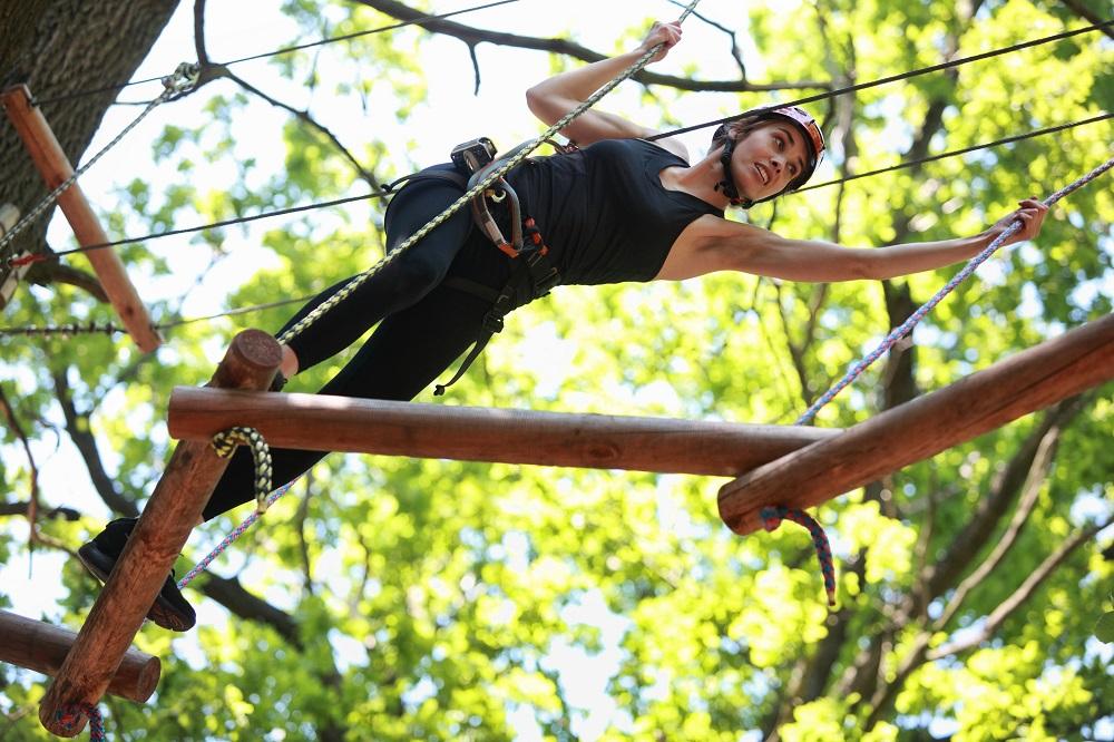 Climbing in adventure rope park. Photo: Marcin Balcerzak/Shutterstock