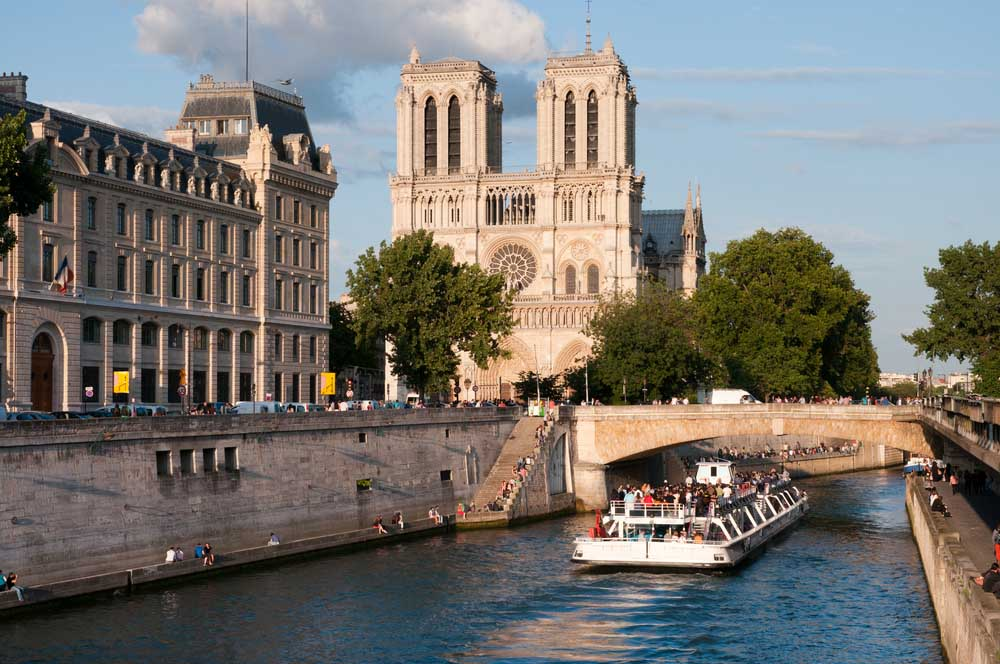 Take a romantic boat trip down the River Seine, close to the Notre Dame Cathedral, Paris