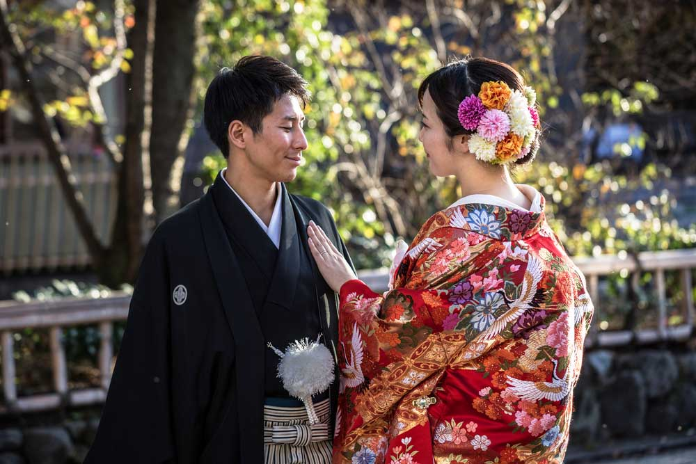 A Japanese couple wearing traditional kimonos in Gion, Kyoto's old town.