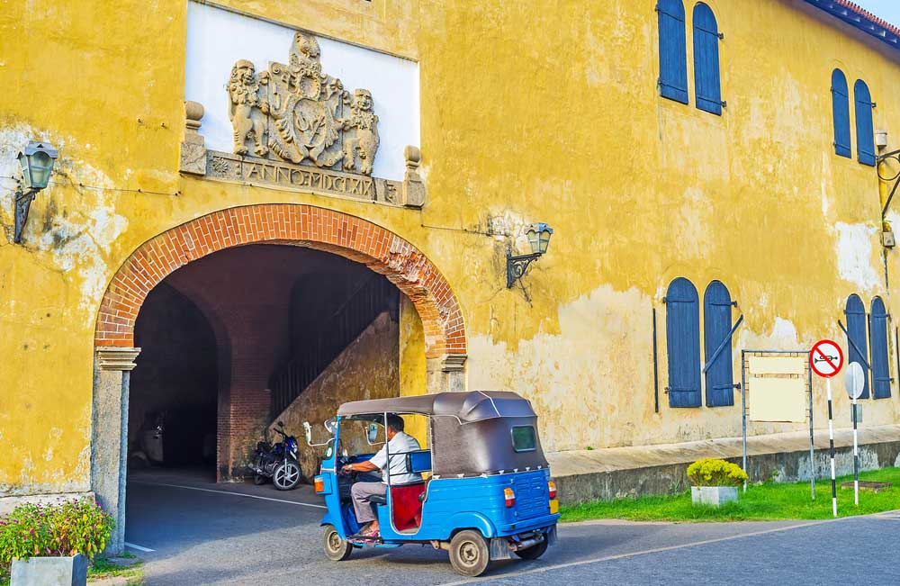 The tuk tuk riding to the exit of Galle Fort through the Old Gate. Photo: Shutterstock
