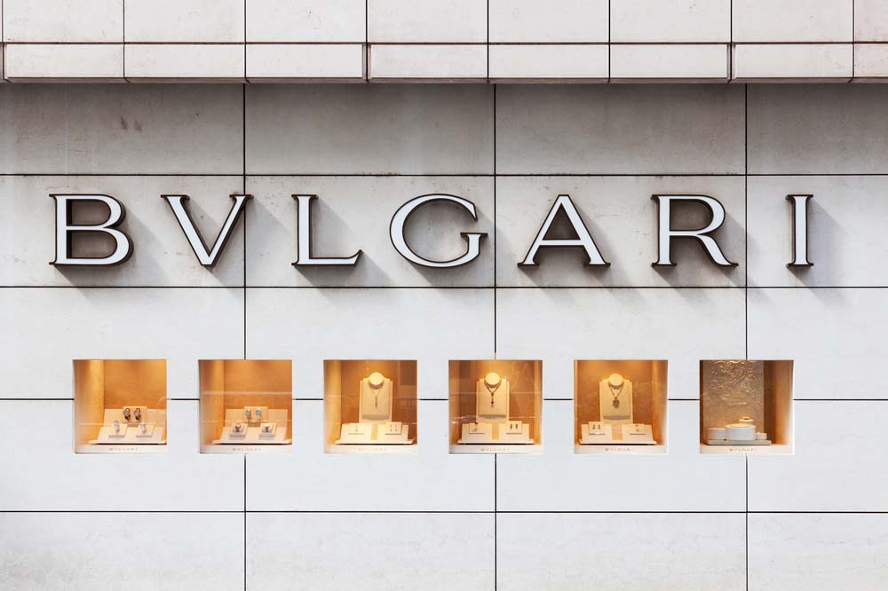 Bulgari sign and window display outside a branch in Central, Hong Kong.