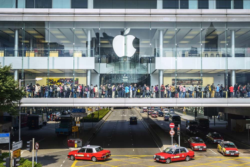 Shoppers try out Apple products while shopping, International Finance Centre, Hong Kong.