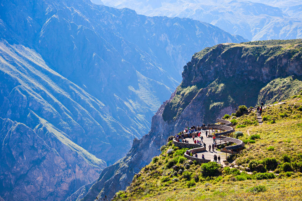 Tourists at the Cruz Del Condor viewpoint, Colca Canyon. Photo: Shutterstock
