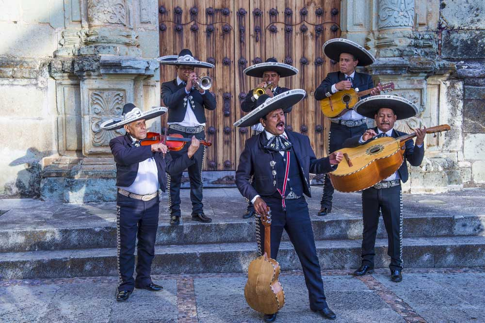 Mariachis perform during the carnival of the Day of the Dead in Oaxaca, Mexico. Photo: Shutterstock