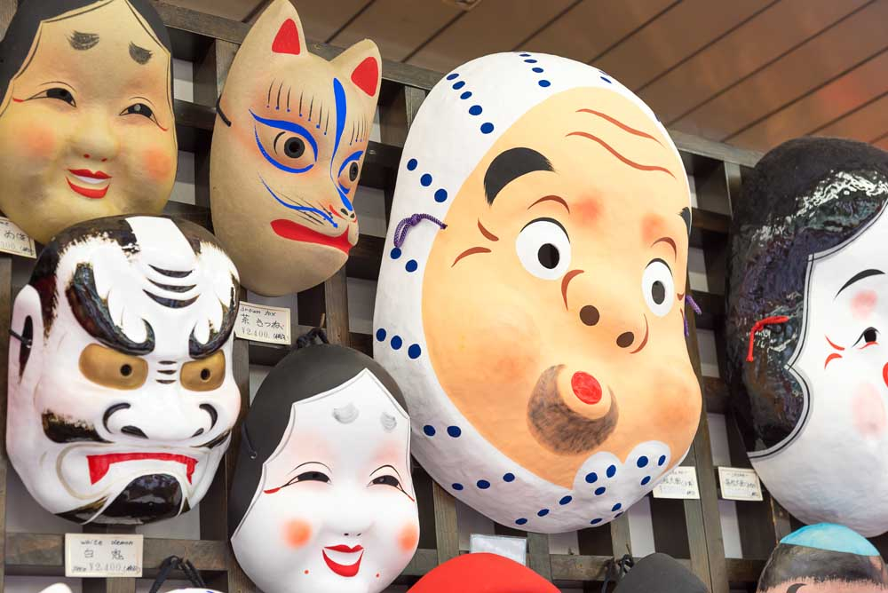 Masks for sale on Nakamise shopping street, near Asakusa Senso-ji Temple