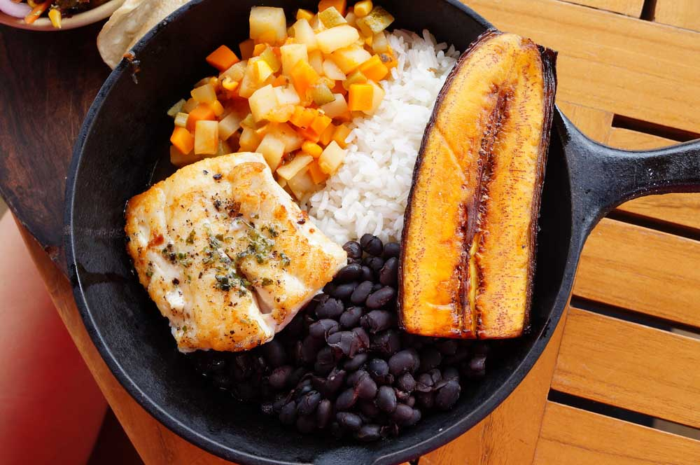 Traditional Costa Rican casado meal with rice, beans, plantains and fish. Photo: Shutterstock