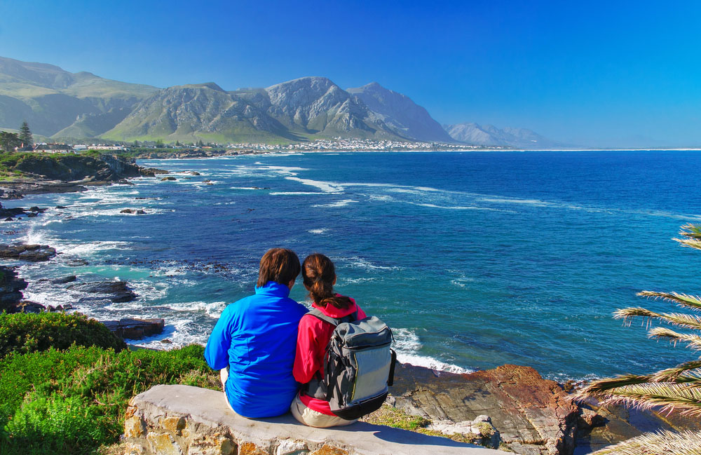 Happy couple looking at beautiful ocean view in Hermanus. Photo: Shutterstock