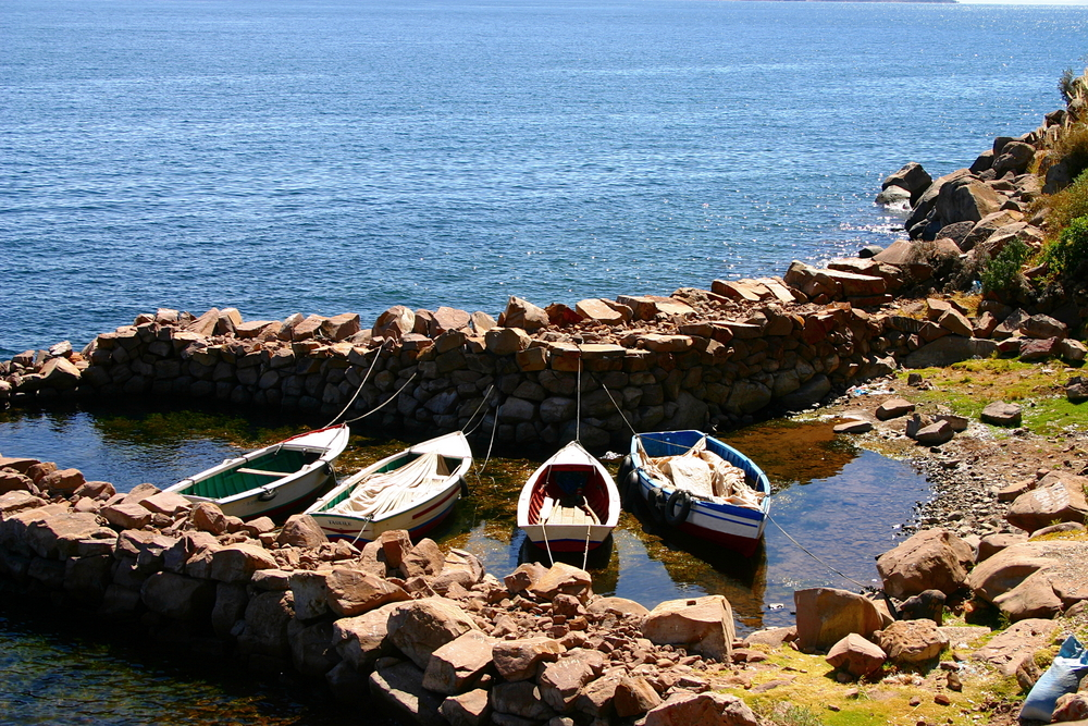 Fishing boats docked in a stone harbor at Taquile Island. Photo: Shutterstock