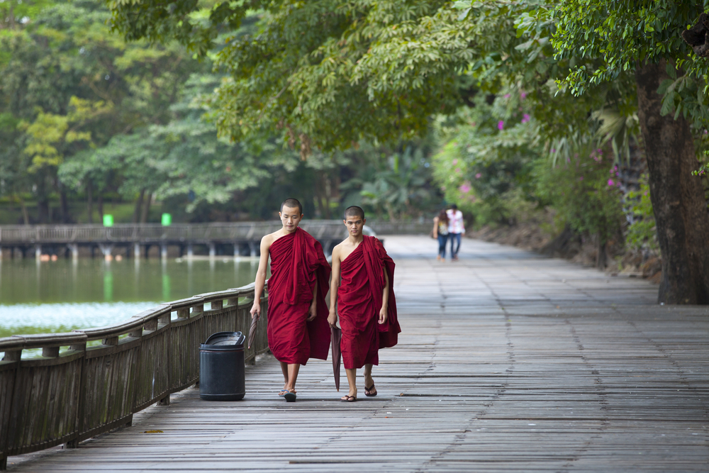 Unidentified monks walk around Kandawgyi Lake and Kandawgyi Nature Park in Yangon. Photo: Shutterstock