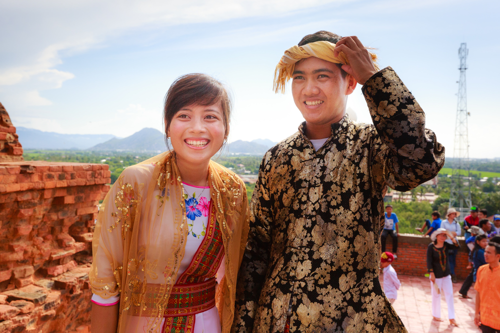 Cham couple visiting a temple. Photo: Shutterstock