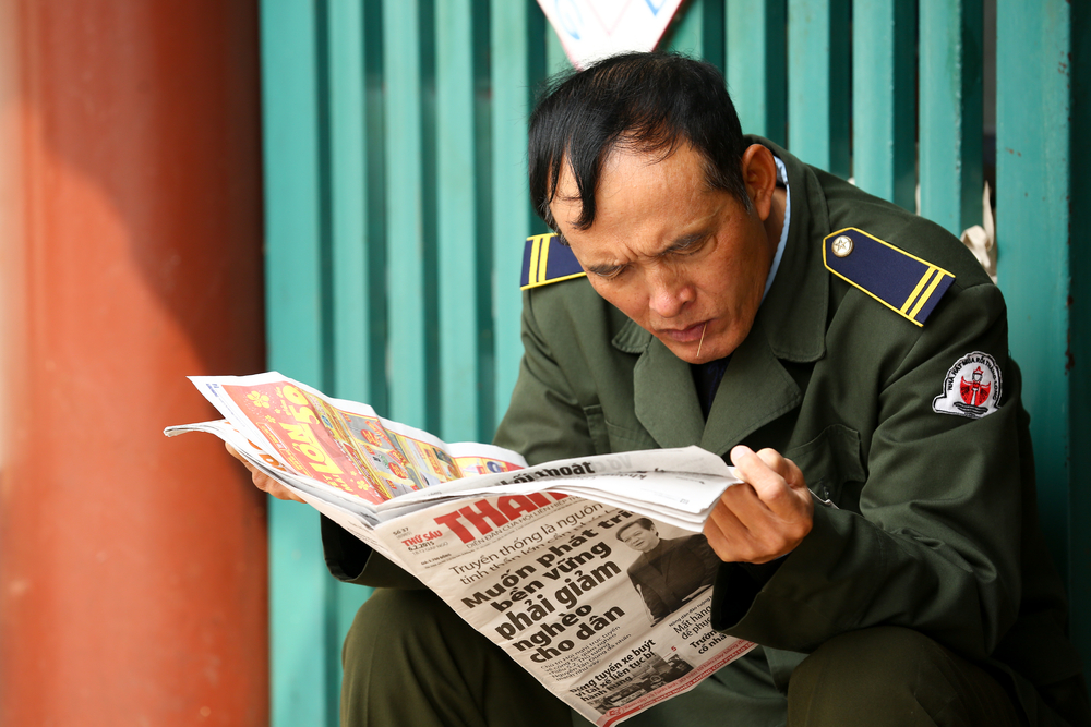 Policeman catching up with the news. Photo: Shutterstock