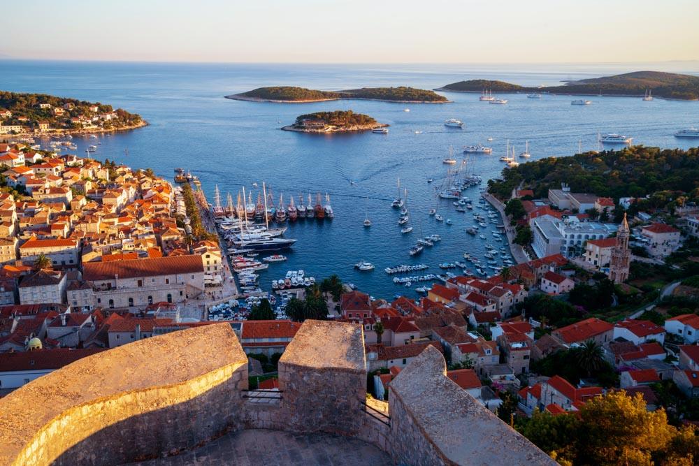 Sunset over Hvar town harbour, Croatia.