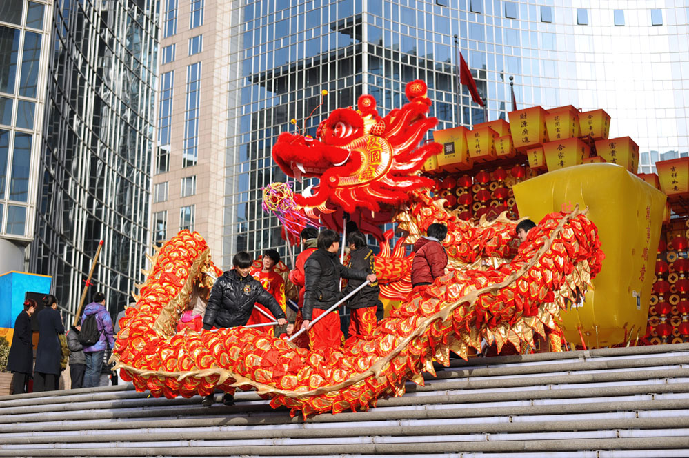 Participants perform the dragon and lion dance during Chinese Spring Festival (Chinese New Year) in Beijing. Photo: Shutterstock