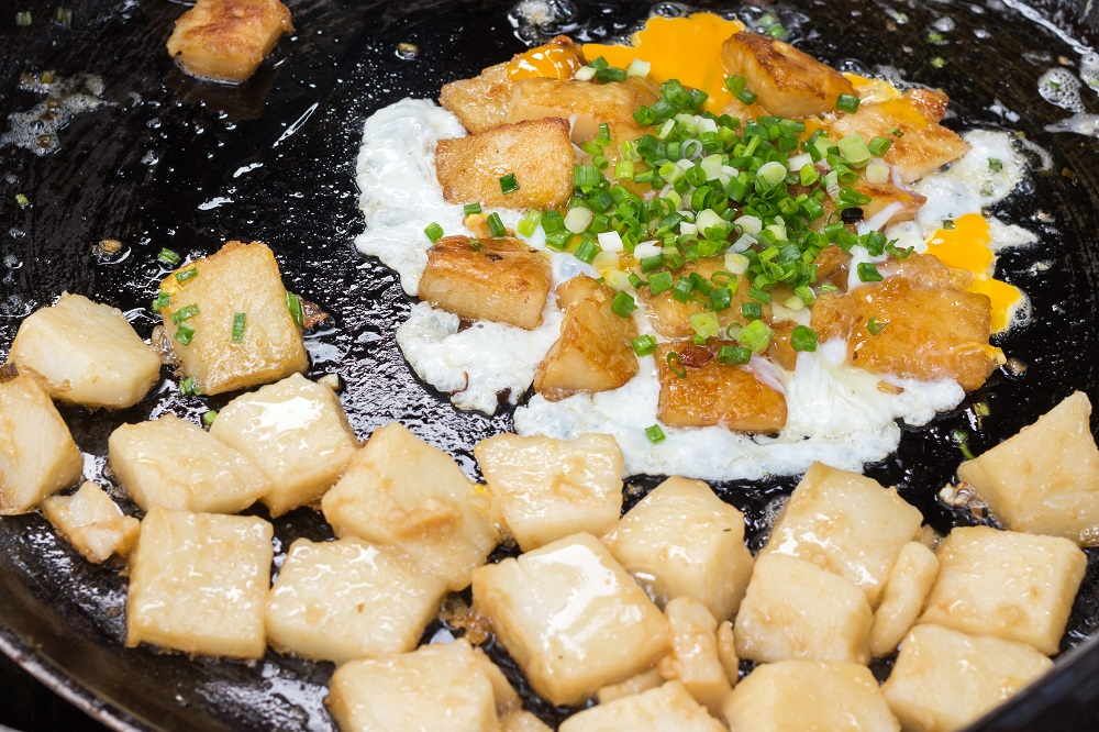 'Bot Chien' Fried rice flour cake with eggs, Vietnamese street food in Ho Chi Minh city. Photo: PJjaruwan/Shutterstock