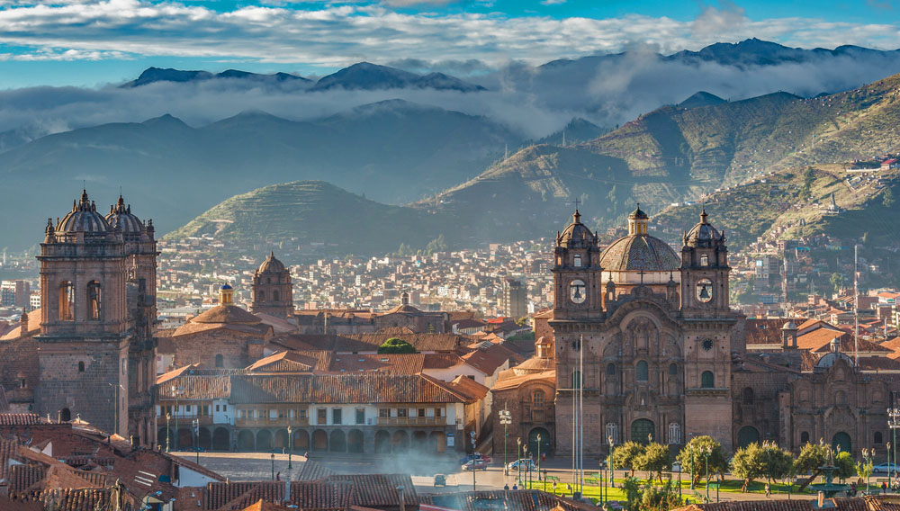 Morning sun rising at Plaza de armas with Adean Moutain, Cusco, Peru. Photo: Shutterstock