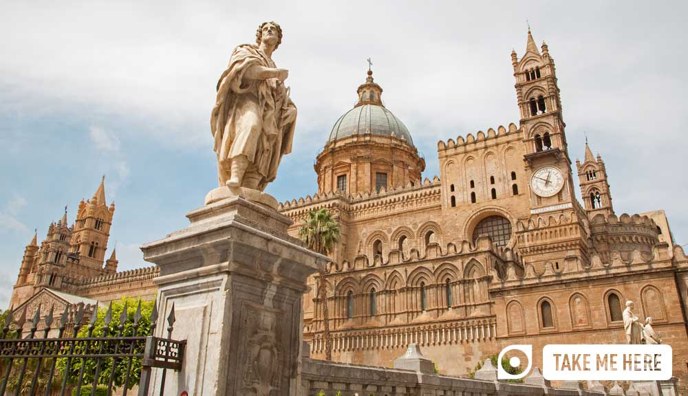Palermo - South portal of Cathedral or Duomo and statue of st. Eustatius