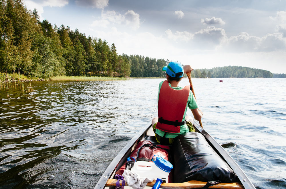 Canoeing in Finland lake.