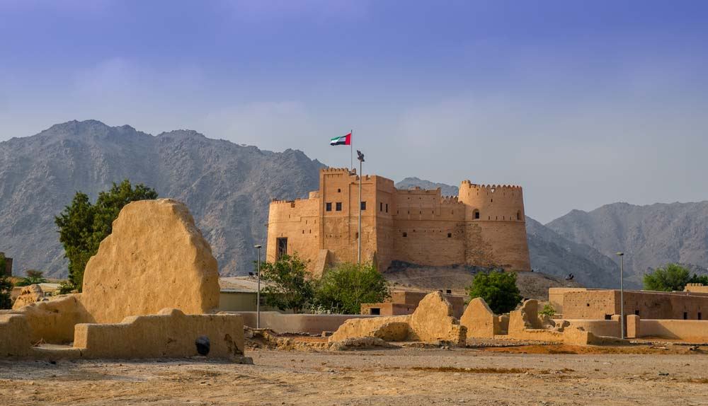 Fujairah fort with a view of ancient village ruins.