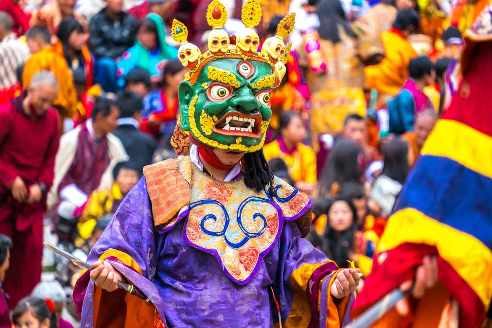 Cham dancer or mask dancer performing the ritual dance at Paro Tsechu in Bhutan, one of the biggest Buddhism festivals held in spring. Photo: Shutterstock