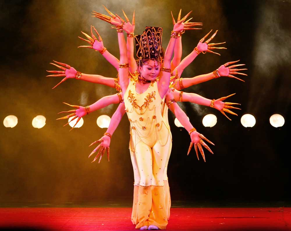A team of dancers from the world famous Shanghai acrobats perform the rhythmic hands of Buddha dance in Shanghai. Photo: Shutterstock