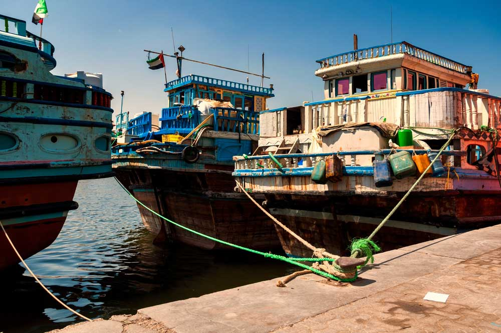 Traditional wooden dhows boats in Dubai creek, Deira. Photo: Shutterstock