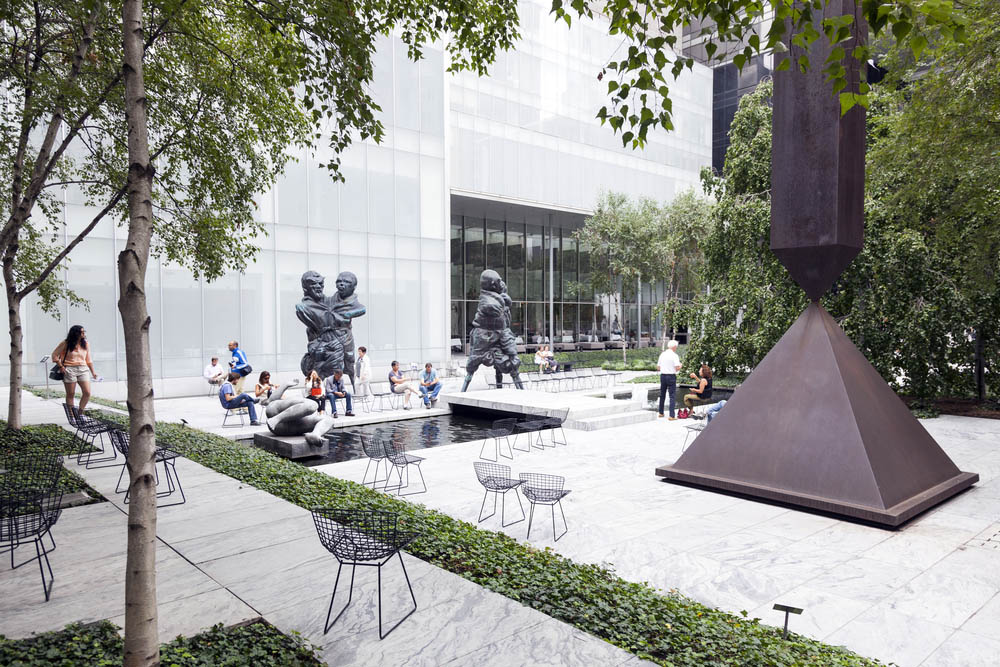 Visitors sit and walk in Sculpture garden of MoMa. Photo: Shutterstock